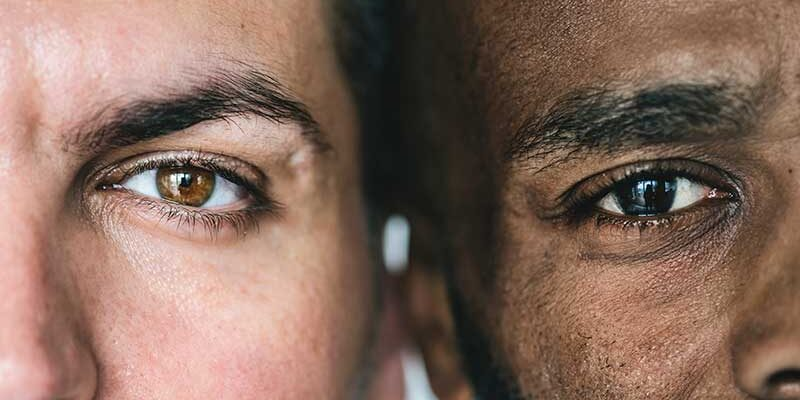two-different-ethnic-men-39-s-eyes-closeup-P68AUHD